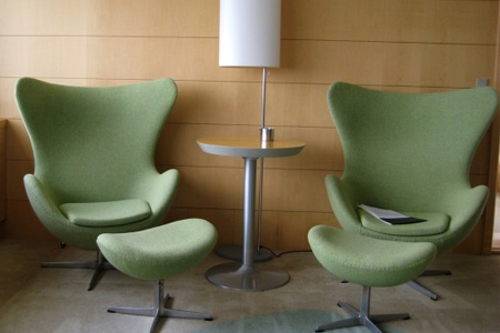Green wool Egg chairs and footstools by Arne Jacobsen